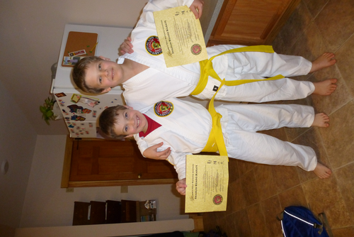 Jonathan and Noah with their yellow belts.