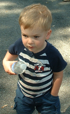 6/1/08 Noah with water bottle and hand in pocket